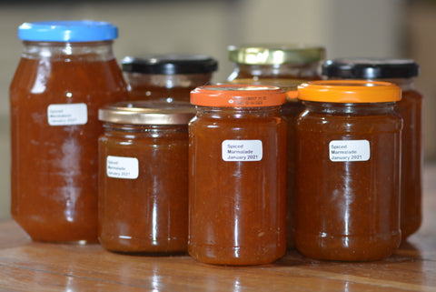 The freshly made marmalade was potted up in a variety of reused jars.