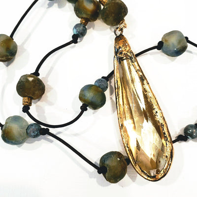 Blue & brown chunky beach glass on natural dark brown knotted leather. Gold leaf