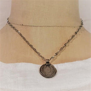 vintage coin on shiny chain necklace
