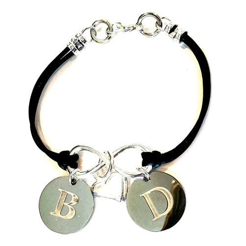 Personalized infinity friendship bracelet engraved with monogram charm