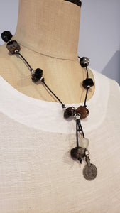 Agate gemstone on knotted leather necklace. Brown, black. Vintage coin