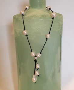 Freshwater baroque pearl necklace on knotted genuine leather with tassel