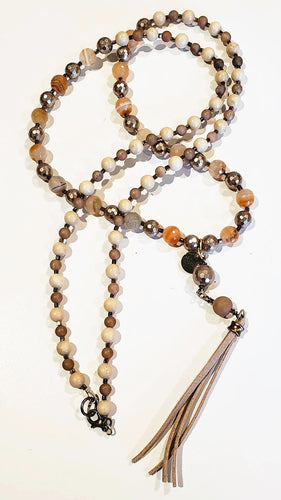 Long creamy neutral golden gemstone necklace with tassel