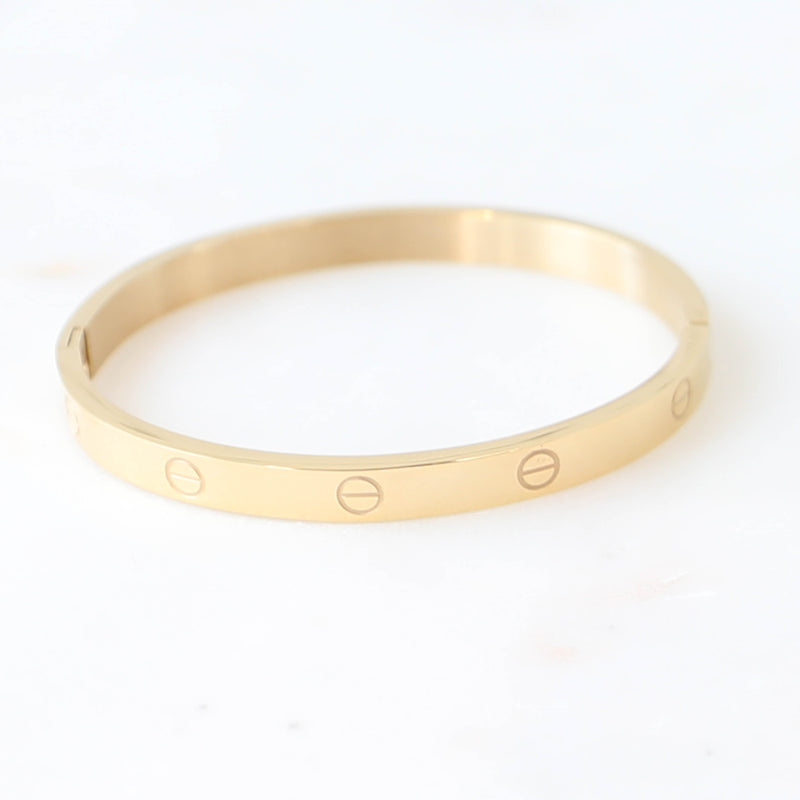 PARPAR</br>Stainless Steel Bangle In Gold Finish