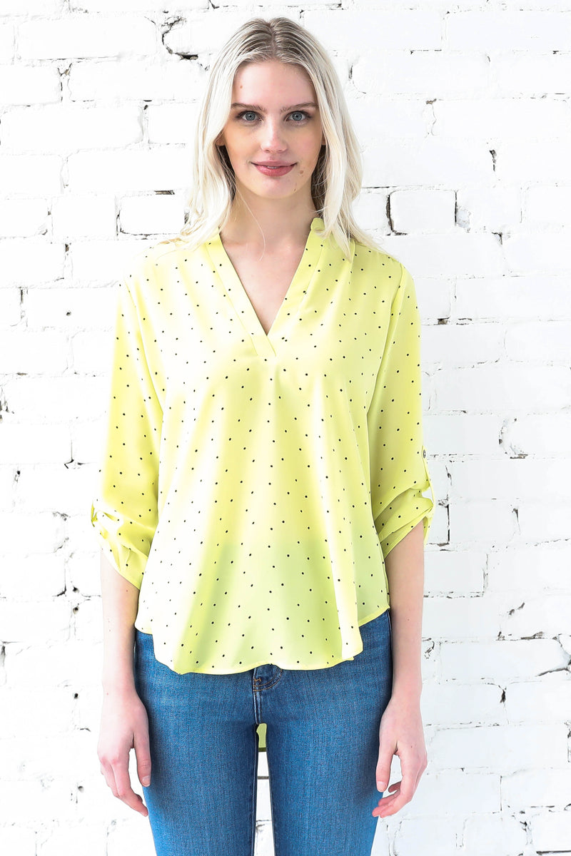 AVERY RAYNE </br>Deep Open V-Neck Printed Blouse