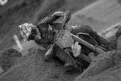 Motocross Rider racing through mud