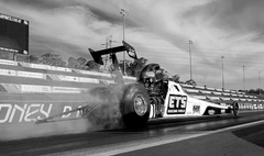 Dragster taking off with smoking wheels