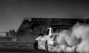 Race Car drifting and kicking up dust