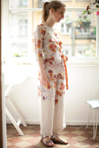 Natural linen with self designed floral print in orange