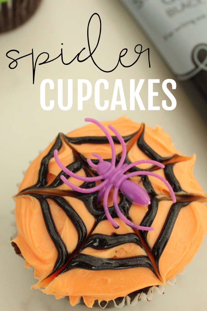 How make chocolate cupcakes with orange buttercream, black spider web icing and purple spider ring.