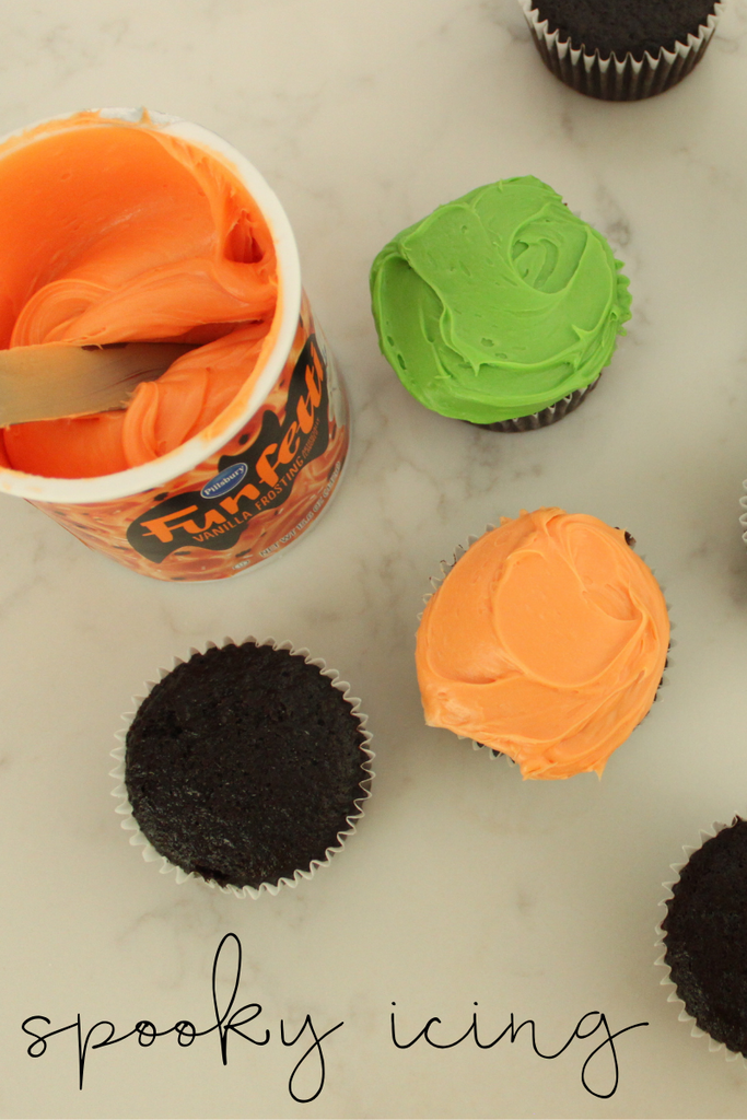 Spread green and orange icing on all your chocolate cupcakes.