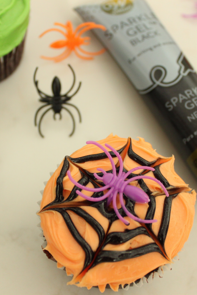 Add a spider ring to finish off your spider web cupcake