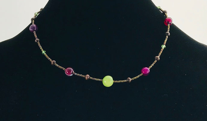 wood, glass and crystal necklace in bronze and plum pink with contrasting green bead