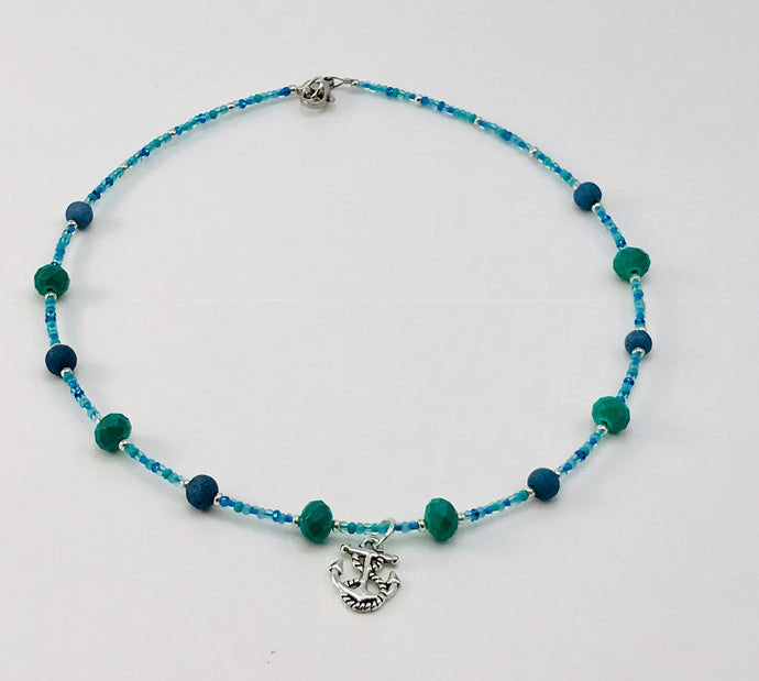 blue and turquoise glass bead necklace with anchor charm