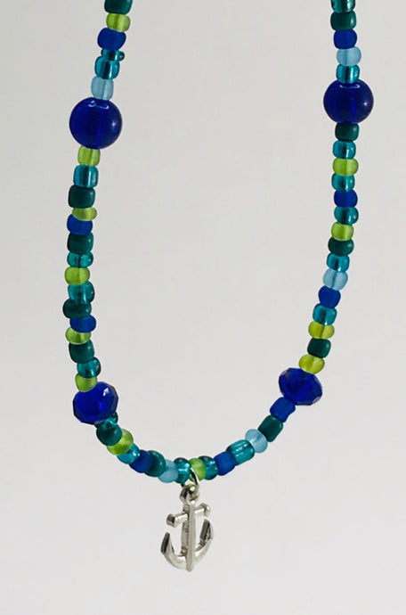 blue and green glass bead necklace with anchor charm
