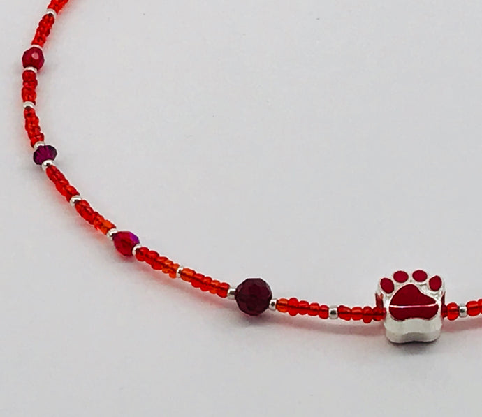 red glass and crystal necklace with paw charm