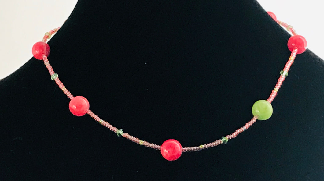 coral pink glass and crystal necklace with contrasting green bead