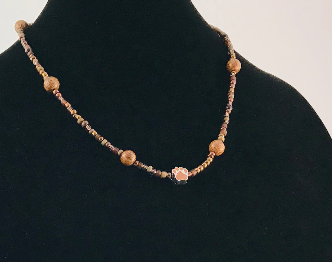 brown glass and wood necklace with paw charm