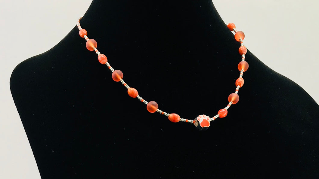 orange and silver glass bead necklace with paw charm