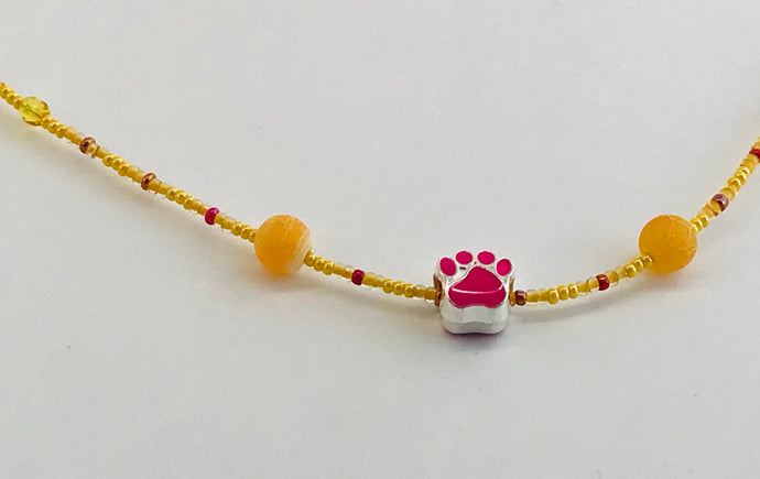 pink and yellow glass bead necklace with paw charm