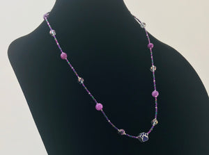 purple and grey glass bead necklace with paw charm