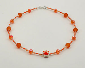 orange glass bead necklace with paw charm