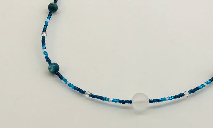 blue glass and crystal necklace with contrasting white glass bead