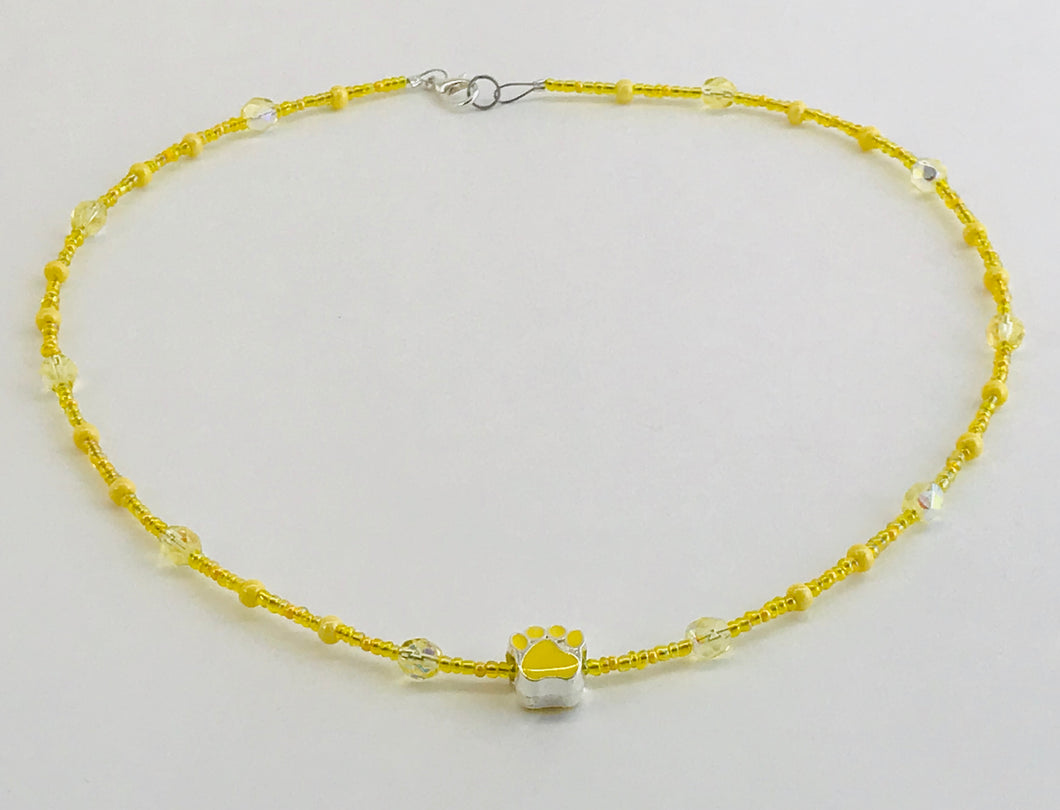 yellow glass bead necklace with paw charm