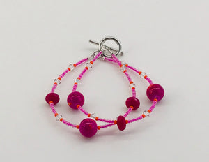 glassand crystal bracelet in pinks and orange with clear accents