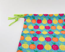 Load image into Gallery viewer, dtawstring bag in blue with pineapple print
