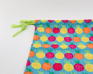 dtawstring bag in blue with pineapple print