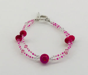 glass and crystal bracelet in pinks and clear/white