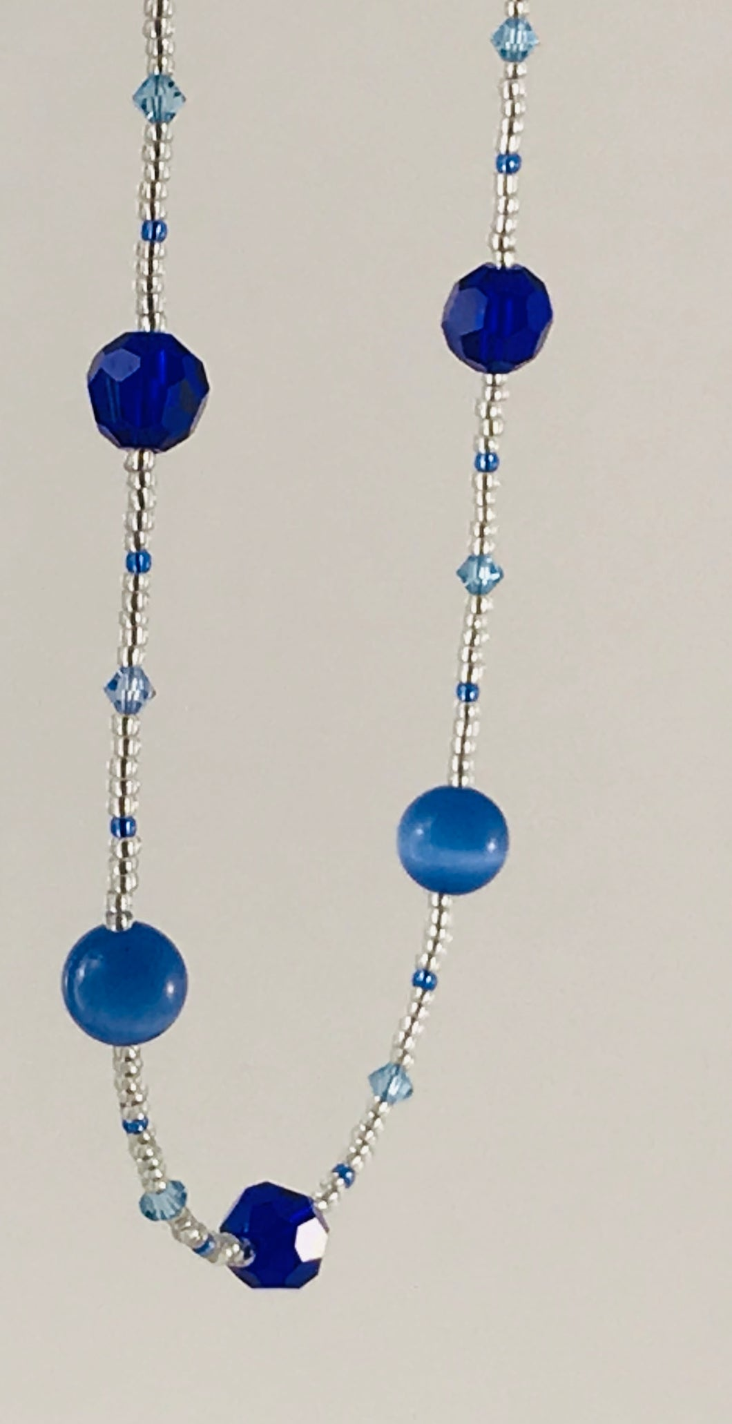 blue and clear glass and crystal necklace