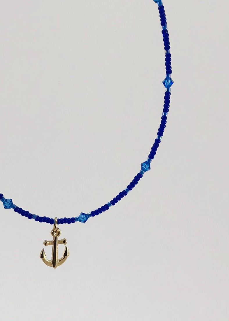 blue glass and crystal necklace with anchor charm