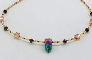 purple and gold glass bead necklace with pendant