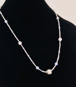 white and clear glass and crystal necklace with paw charm