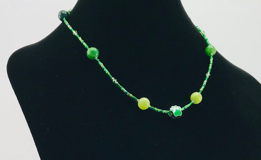 green glass and crystal necklace with paw charm