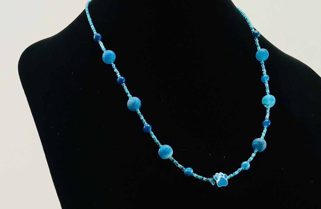 blue glass bead necklace with paw charm