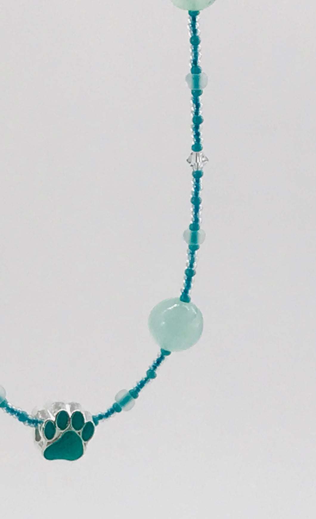 turquoise glass and crystal necklace with paw charm