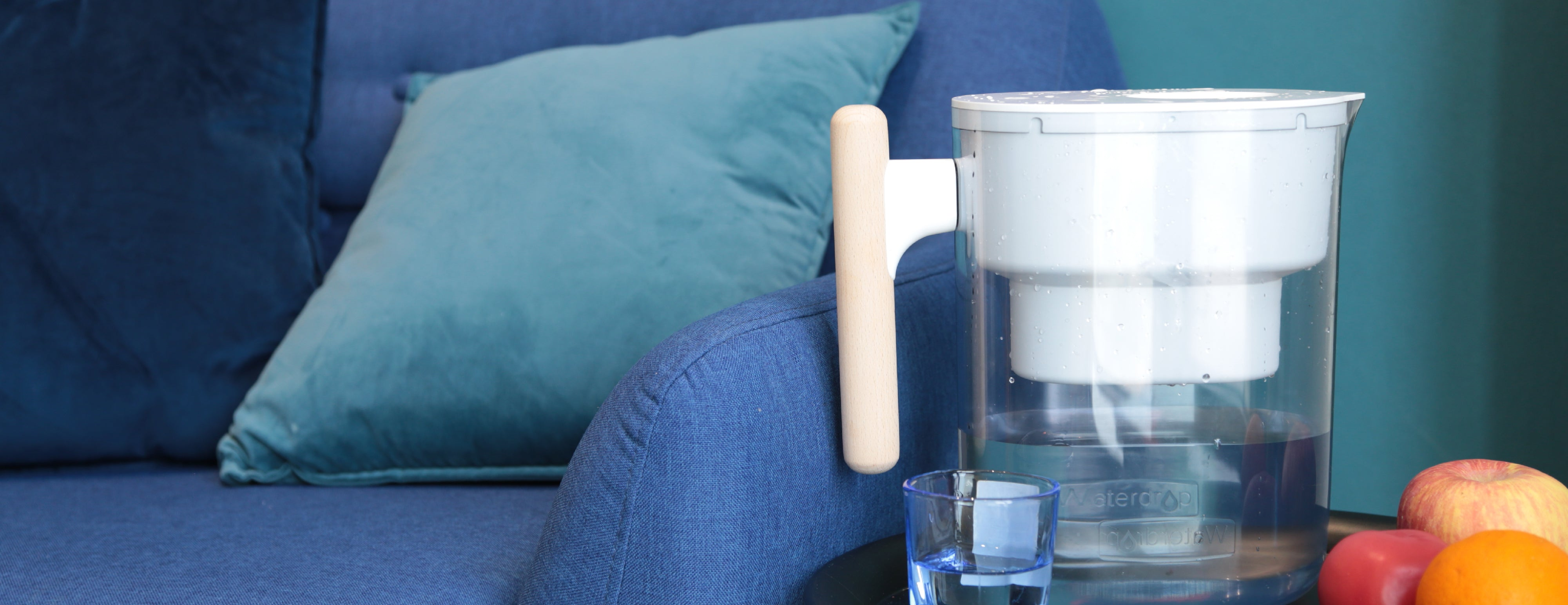 A water purifier pitcher on a couch