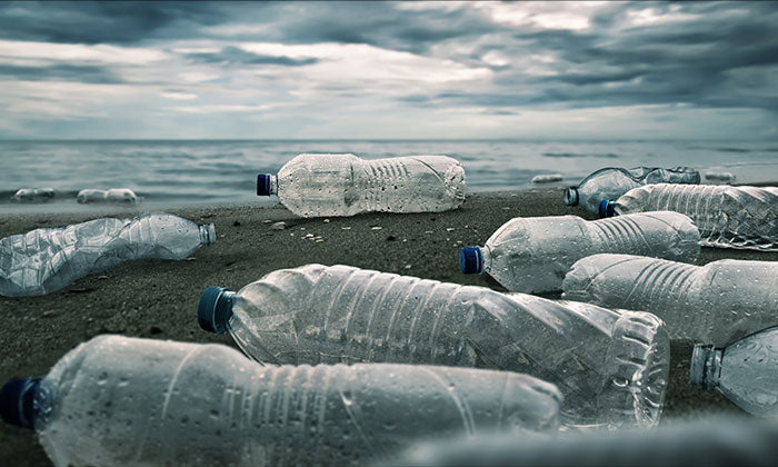 plastic water bottles on the beach