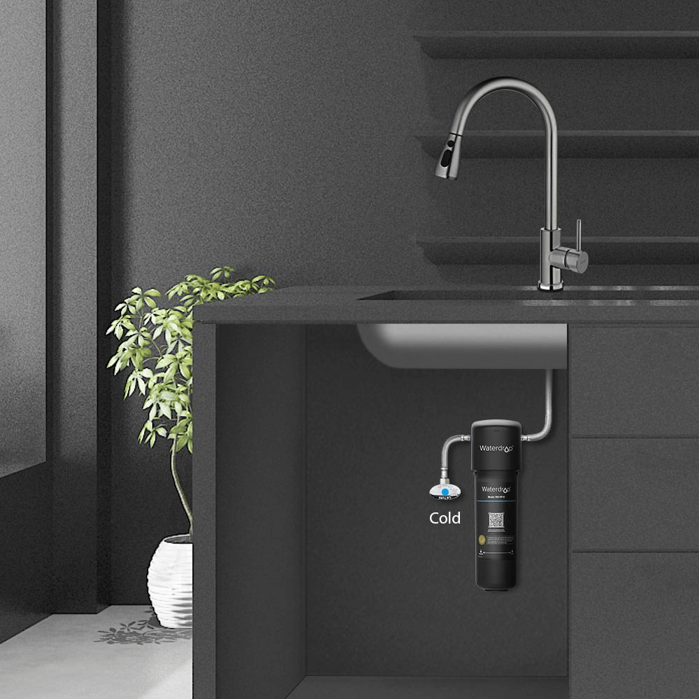 The undersink scene with a water filtration system installed