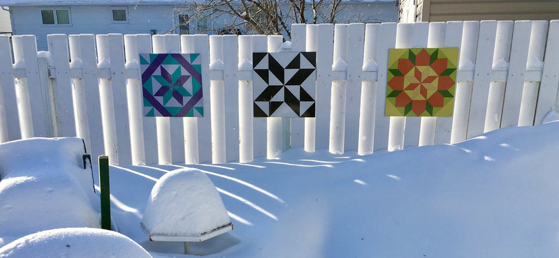 Barn Quilts on a  Winter Fence
