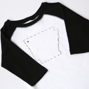 hand-drawn print of the state of Arkansas on the front of a raglan sleeve toddler top