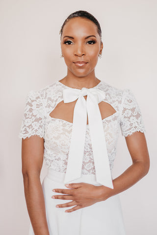 Lace bridal bodice with large bow and key hole design in front