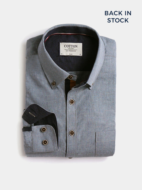 Cotton the First Slim Fit shirt. Shop local San Francisco style. light blue chambray, wood button, blue orange trim.