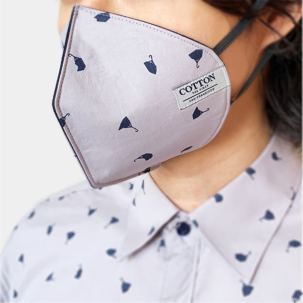 Reusable face masks in fun umbrella pattern made with three layers of cotton fabric, adjustable straps, soft and comfortable, easy to breathe. Made in the USA.