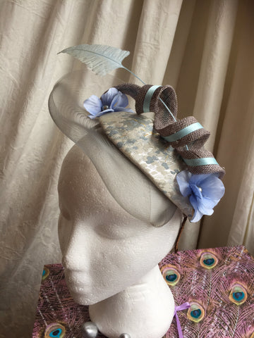 wedding guest haat , headpiece, soft grey and power blue,teardrop base, with sinamay swirl blue hydrangea petals, with a crinoline designed brim, little rose design original millinery, irish designer, bride, mother of the groom, mother of the bride, horse racing event, many colours available