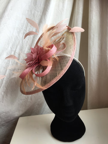 large brim pastel pink headpiece, with soft pink  feather flower centre, coq feather, sinamay base , swirled , on a headband, hat , headpiece, tocados, fascinator,mother of the bride, handmade, irish designer, little rose design original, millinery