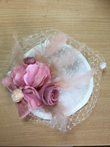 Rounded cream sparkle base, 15cm, with pastel pink rose, flowers, sweet pea design , with added widows veiling in a birdcage addition, little rose design original, spring piece, hat, headpiece, fascinator.